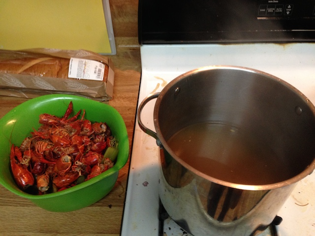 Left: crawfish bodies and stock veggies in a bowl. Right: my precious stock.
